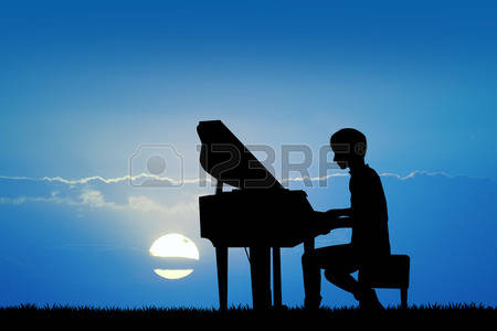 43288157-man-plays-the-piano-at-sunset